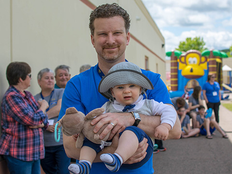 AA Financial teammember and child at our 75th Anniversary Celebration
