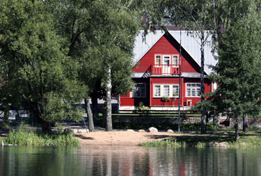 red cottage on lake in Nova Scotia